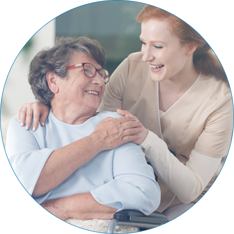 Caregiver and patient smiling at each other.